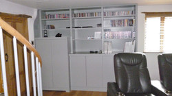 Bespoke, built in in media unit and book shelves. Painted finish