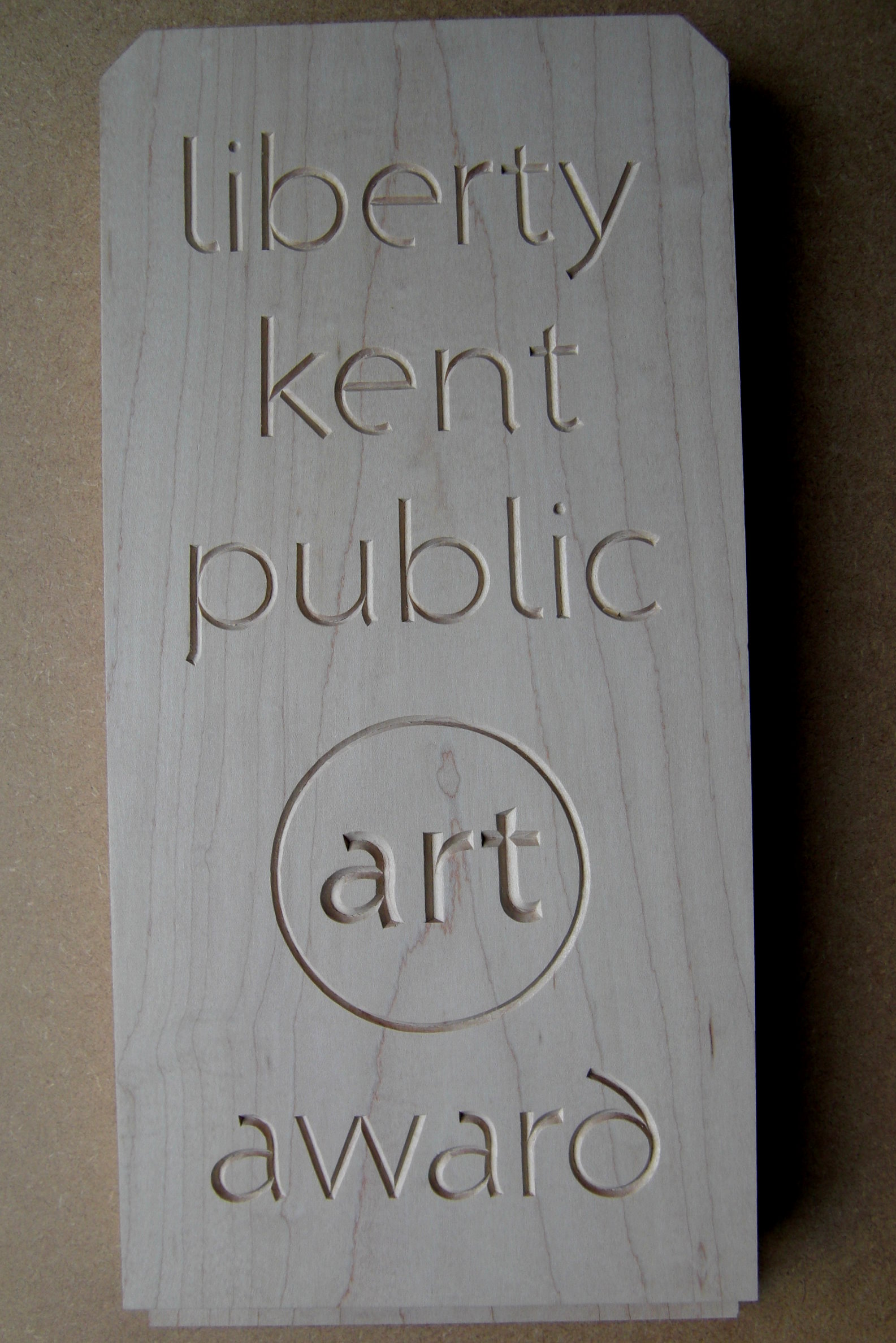 Carved lettering for art award, in maple wood