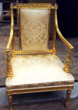 Carved and gilded chair. 1 of a set