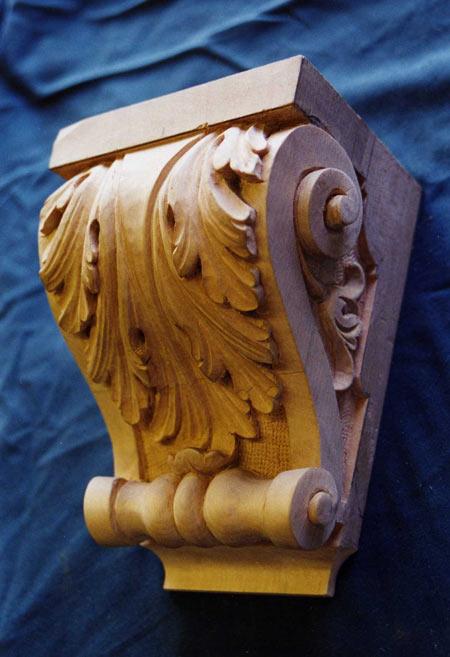 Carved corbel in mahogany