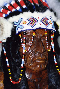 Carved head of native American Indian in mahogany