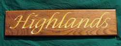 House sign in oak with carved and gilded lettering