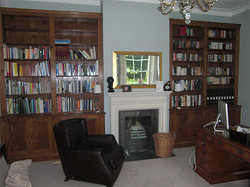 Pair of fitted bookcases in oak