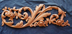 Carved frieze for fire surround in mahogany