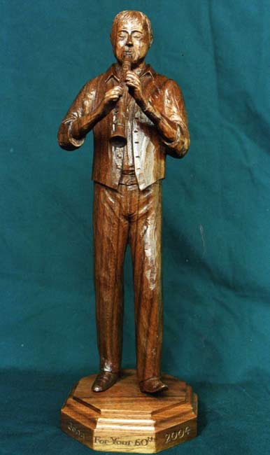 Carved figure of clarinetists in walnut