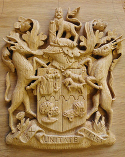 Hand carved, heraldic shield. In oak, 8 inches high
