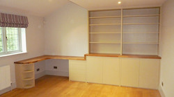 Modern built in desk and bookcase, bespoke furniture. Oak top with painted units