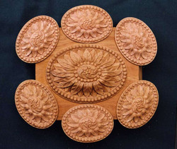 Carved discs to be applied to furniture in mahogany