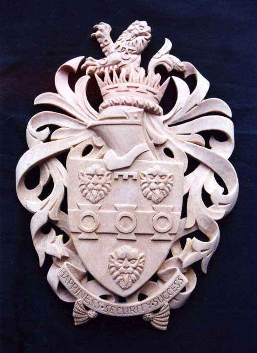 Carved coats of arms in Lime wood