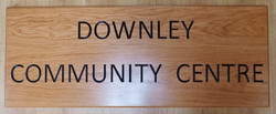 Wooden sign with carved and painted lettering