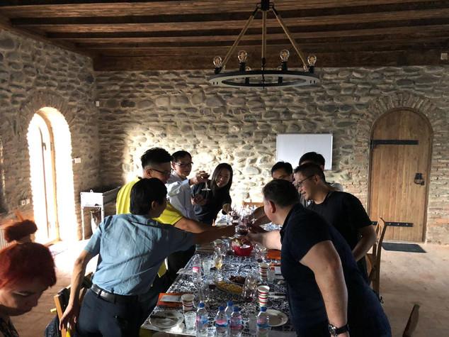 A group of visitors from Hong Kong toasting and enjoying our wines at Kapistoni Marani.