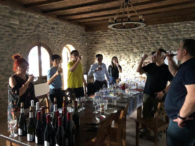 A group of visitors from Hong Kong enjoying a tasting of our wines at Kapistoni Marani.