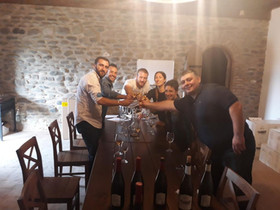 Visitors from Italy enjoying a tasting of our wines at Kapistoni Marani.