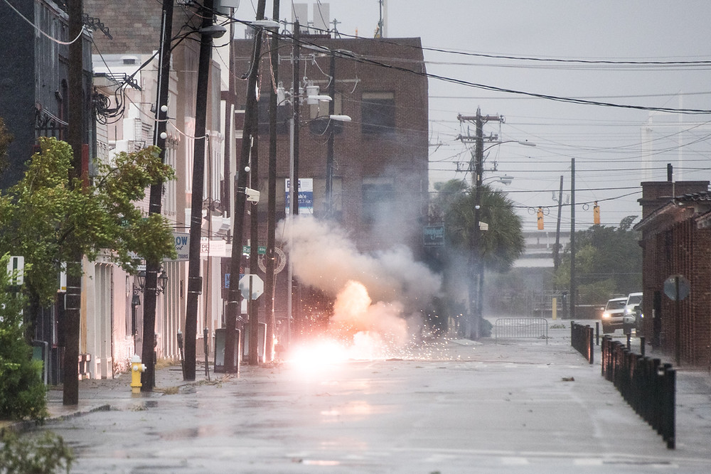 power lines sparking on flooded street in downtown Charleston