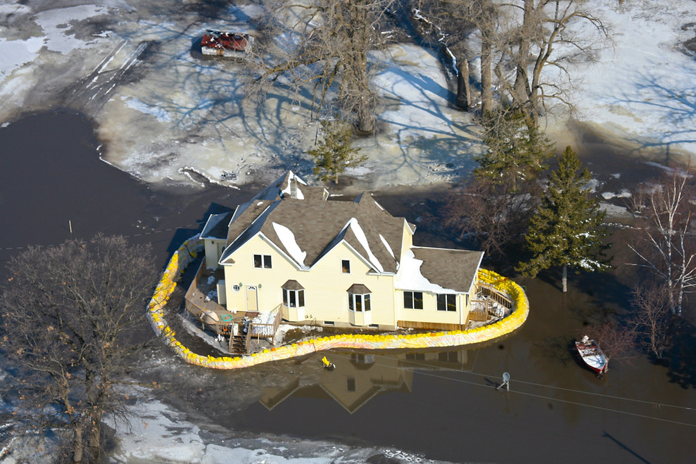 A house surrounded by sandbags during the 2009 Minnesota floods.