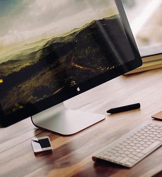flat-screen-monitor-beside-white-iphone-