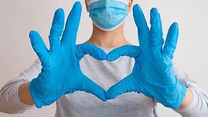 Woman with a medical mask and hands in l