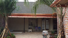 Bronze bell shape awning with metal sides