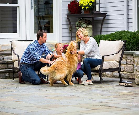 family with dog backyard patio