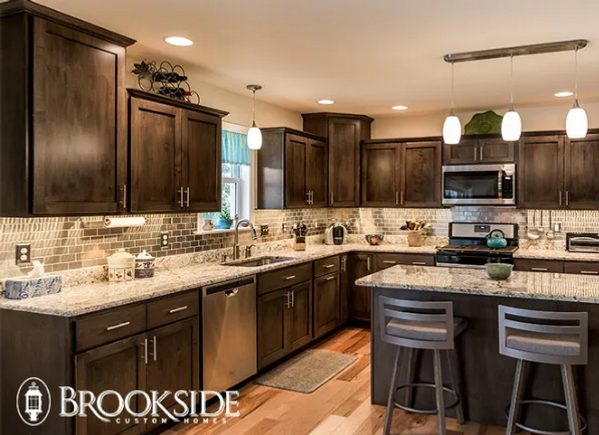 kitchen with island brown cabinets backsplash
