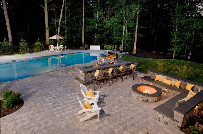 hardscpaping stone patio, firepit and swimming pool