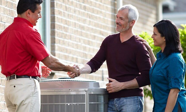 hvac system contractor shaking hands with clients