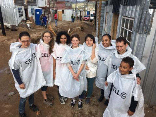 Brownyn and other volunteers wearing ponchos preparing to spendthe day in Mandela Square painting shacks
