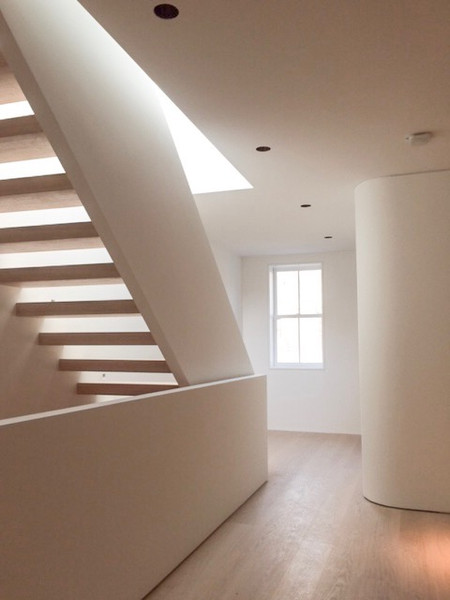 RoundSquare Builders & Space4Architecture adds skylight staircase to minimal Brooklyn townhouse