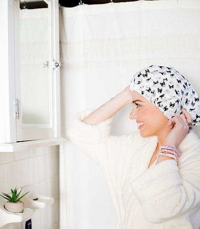 Woman wearing The Frenchies ShowerShell and the Pink Silk scrunchies.