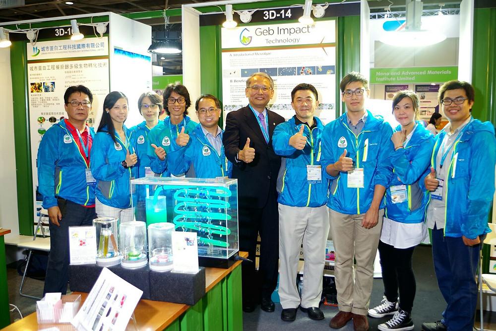 Staff members with photobioreactor model and immobolised algae beads