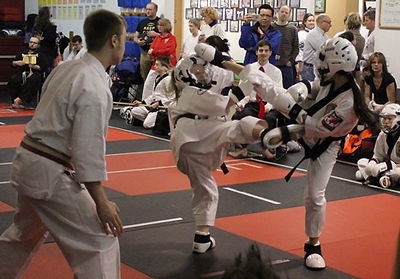 Teens in Karate Tournament Sparring