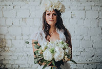 Bride holding wedding flowes