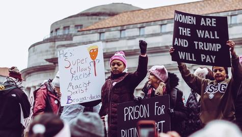 5. Black woman raising a fist in a sea of white women