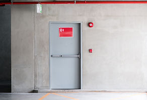 Fire exit door for emergency case of the parking building near the business office._.jpg