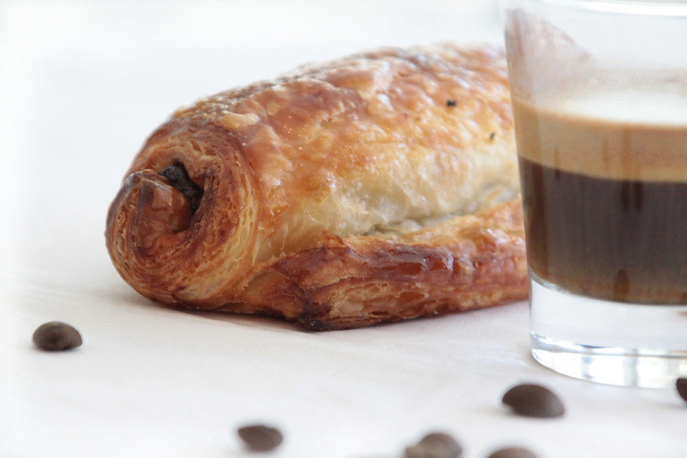 A coffee and a pastry