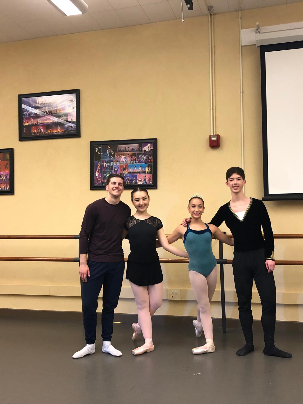 Emma, Brent, LilaRose and Christian warm up for the Pas de Deux/Ensemble competition.