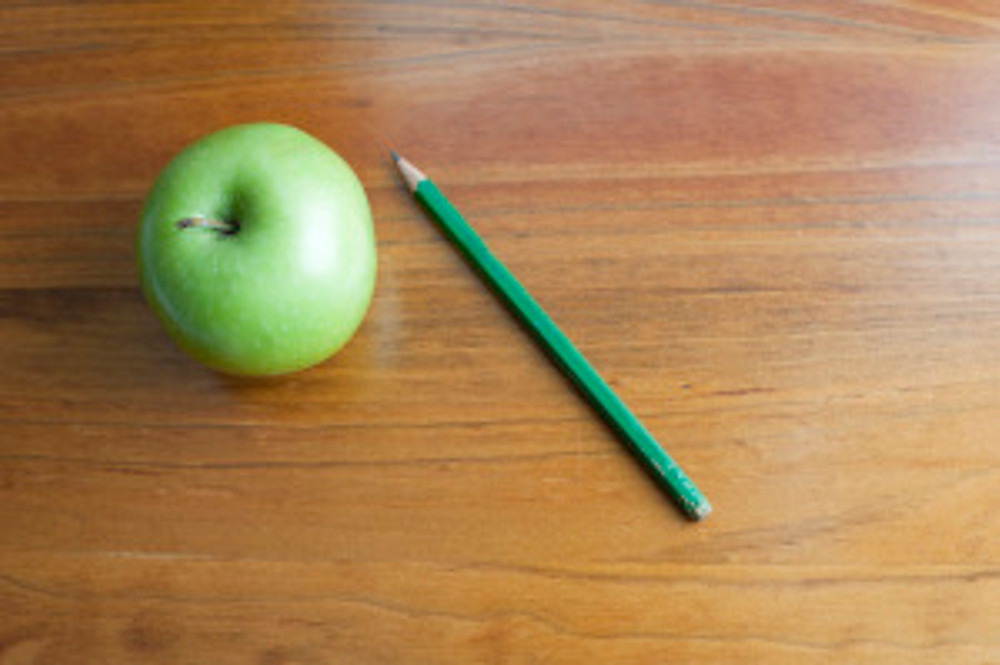 Apple on a school desk