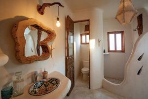 Chic, Rustic bathroom in the Zorba private villa in Tulum.