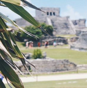 This beautiful photo of the Tulum Ruins via Instagram at @compass_and_passport.