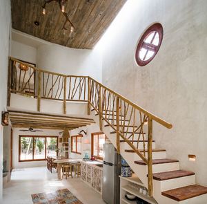 Inside one of Zorba's private villas, a sweeping staircase made of natural materials.