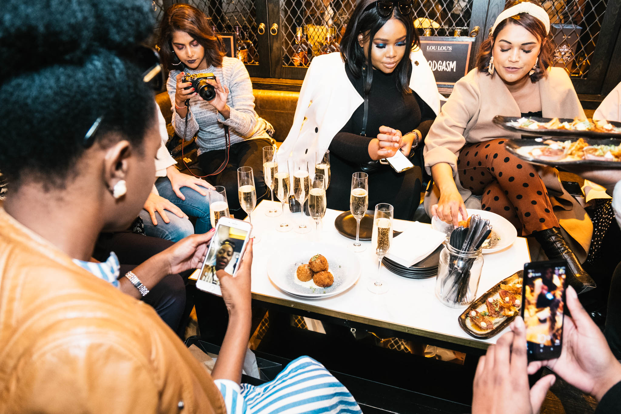 Influencers enjoy bubbly and food at LouLou's after a long day of media activities