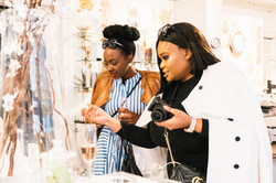 Influencers looking at products in Victorian Bathrooms at the Cape Quarter