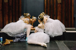 Backstage ballerina huddle