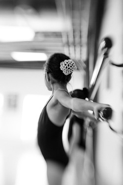 Young ballerina at the barre