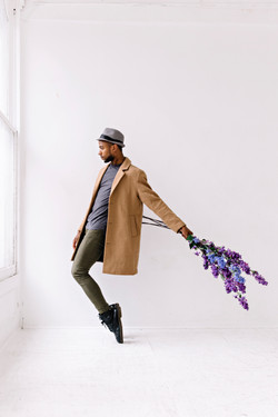 Dancer Christopher Wilson with flowe