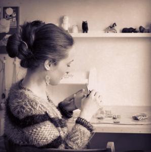 Artist in her jewellery studio