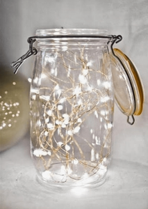Masonry jar filled with fairy lights courtesy of http://paperandlace.com/