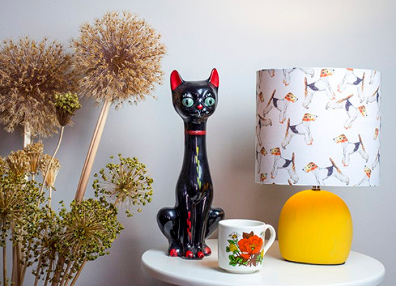 table lamp with porcelain cat and a mug