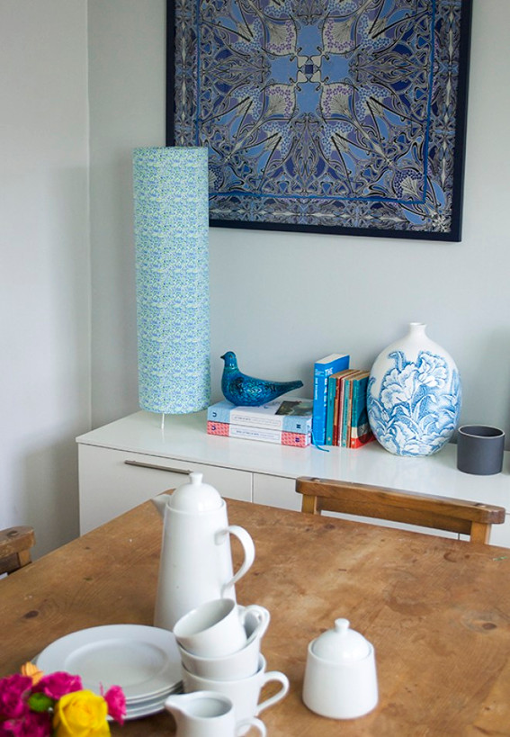 Kitchen sideboard with lampshade and books