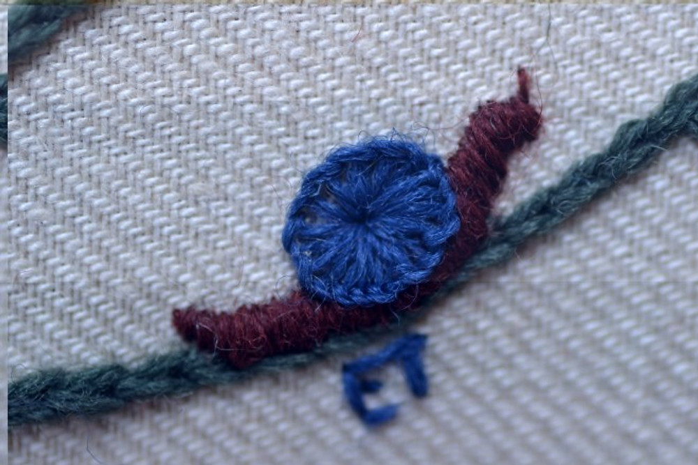embroidery close up of snail